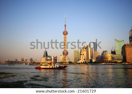 A boat cruises past the Oriental Pearl building on the Huangpu River in Shanghai.