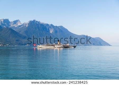 A boat floating in Geneva lake in Switzerland - stock photo