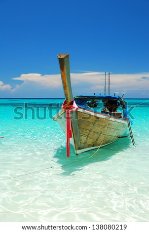 A boat floating on the blue sea