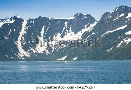 A boat in Kenai Fjords National Park, Alaska - stock photo