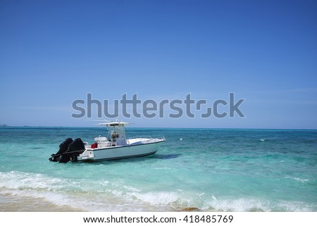 A boat in the surf in the Bahamas.