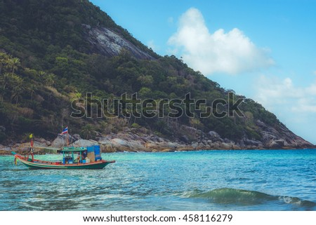 A boat is landing on Bottle Beach, on Koh Pha Ngan, Thailand