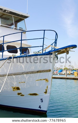 A boat moored at the at the marina. - stock photo