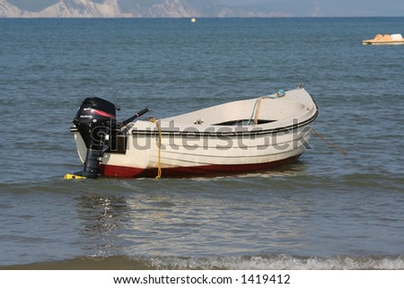 A boat moored out to sea