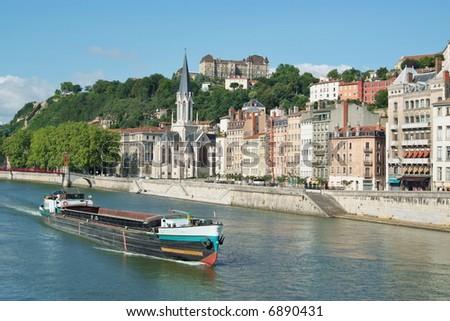A boat on the river Saone running through the city of Lyon in France - stock photo