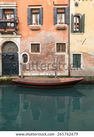 A boat outside a building in Venice during the day - stock photo