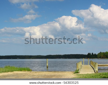 a boat ramp landscape over the piankitank river in virginia with room for your text - stock photo