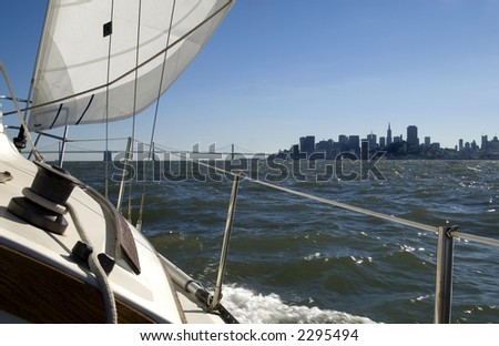 A boat sails by San Francisco. - stock photo