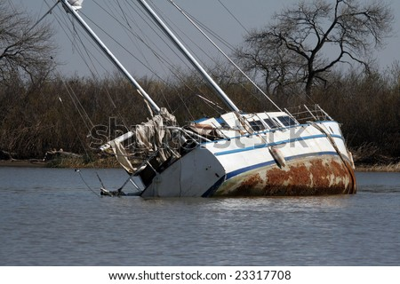 a boat sinking in the lake - stock photo
