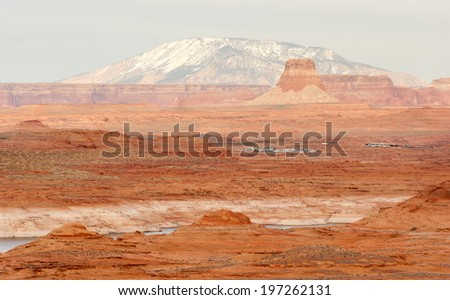 A boat storage lot is tucked away in the red rock landscape of lake powell - stock photo
