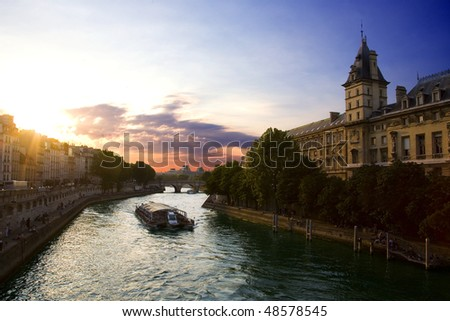A boat tour at sunset on the Seine river in Paris, France. - stock photo