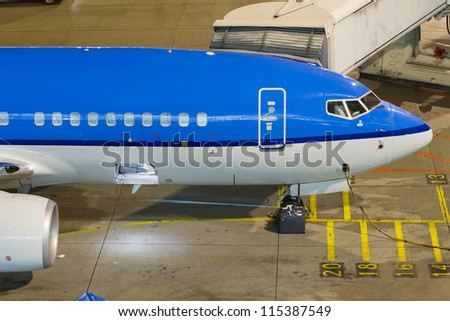 A boeing 737 parked at the gate. - stock photo