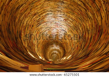 a book tunnel in Prague's library. Yes, mirrors are used to create this effect.