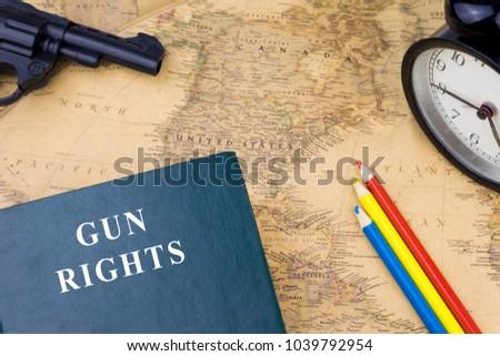Book text gun right color pencil stock photo download now a book with text gun right color pencil gun and alarm clock on a gumiabroncs Image collections