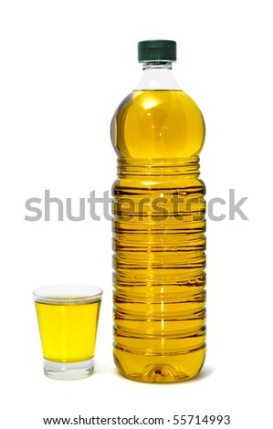 a bottle and a glass of olive oil isolated on a white background
