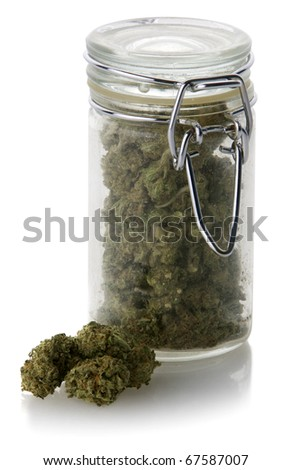 A bottle full of medicinal marijuana isolated on white with a reflection