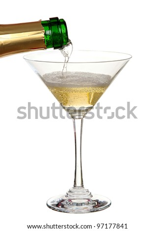 a bottle of champagne being served in a cup - stock photo