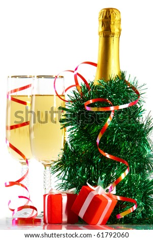 A bottle of champagne in spangle with two full glasses and small gift boxes - stock photo