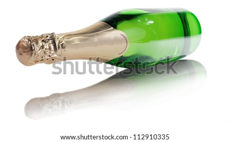a bottle of champagne on isolated white background - stock photo