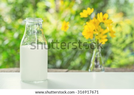 a bottle of milk with nature background.
