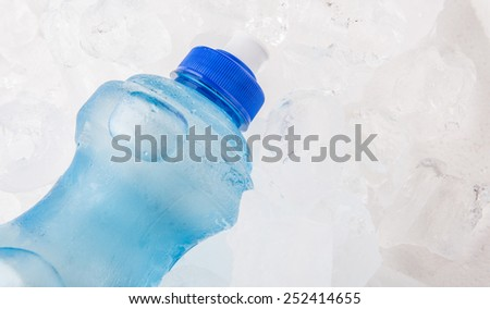 A bottle of mineral water on ice cubes