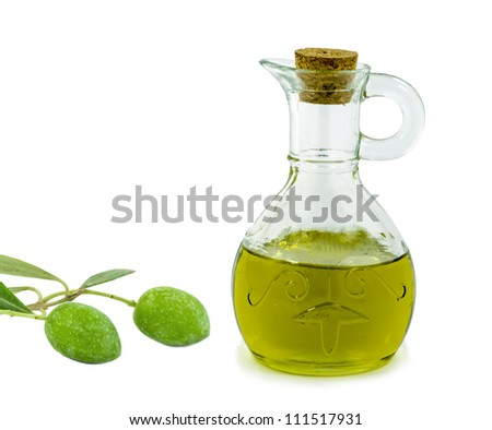 A bottle of olive oil and green olives on white background
