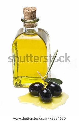 A bottle of olive oil and some premium olives with leaves isolated on a white background. - stock photo