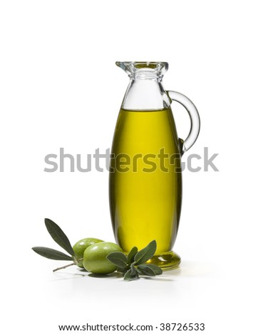 A bottle of olive oil with two olives and sage on white background - stock photo