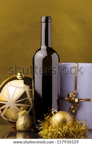 a bottle of red wine,Christmas decoration, gift boxes - stock photo