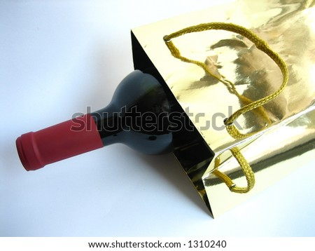 A bottle of red wine in a golden bag