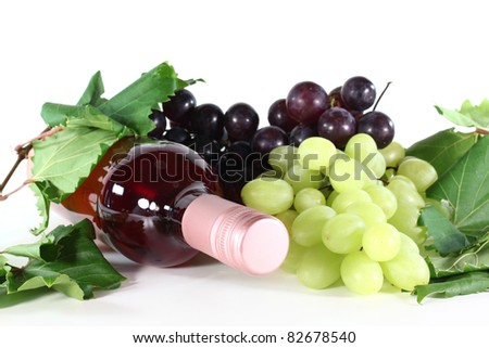 a bottle of rose wine, grapes and vine tendril on a white background