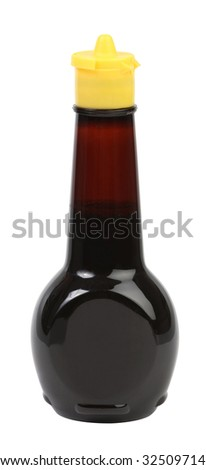a bottle of soy sauce with a yellow lid - stock photo