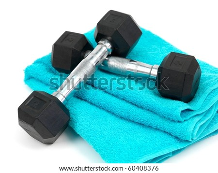 A bottle of water and a sports towel isolated against a white background