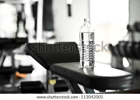 A bottle of water on the sport equipment - stock photo