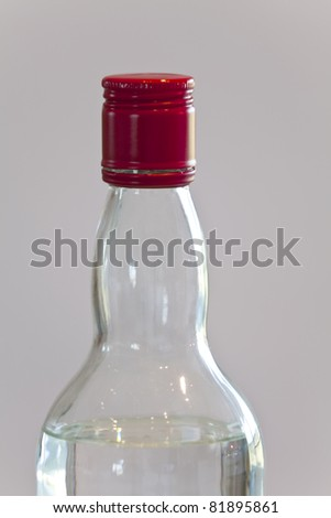 A bottle of white spirit with red top - stock photo