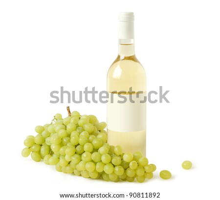 A bottle of white wine and a branch of grapes - stock photo