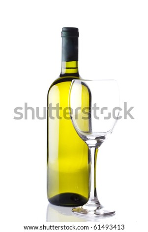 a bottle of white wine and a wine glass isolated on white - stock photo