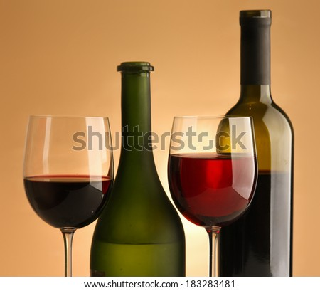A bottle of wine and two glasses - stock photo