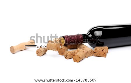 A bottle of wine, corks and corkscrew. - stock photo