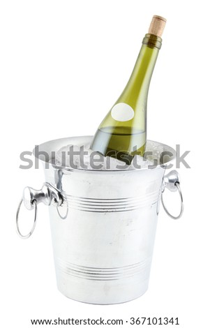 A bottle of wine in an ice bucket. Isolated - stock photo