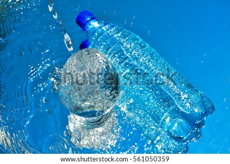 A bottle on water background