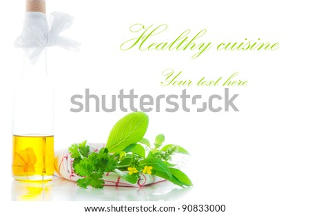 A bottle with olive oil and some herb on white background with a area for you text - stock photo