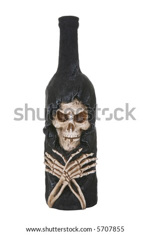 A bottle with skeleton representing the dangers of drinking - stock photo