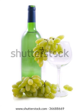 A bottle with white wine and grapes isolated