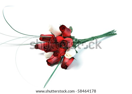 of a dozen roses that are made of wood, isolated on a white background ...