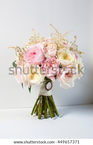 a bouquet of flowers on a white background wedding bouquet of pink and peach roses .