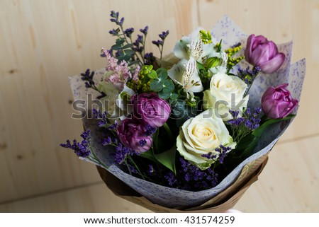a bouquet of flowers on wooden background