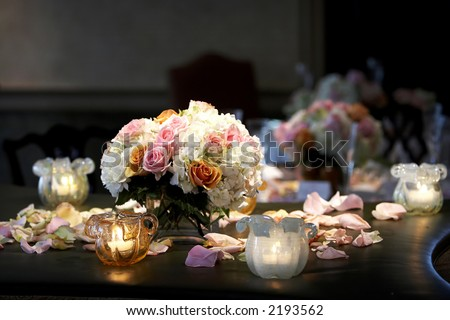 A bouquet of flowers with candles taken during a wedding event - stock photo