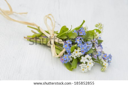 a bouquet of for-get-me-nots tied with raffia - stock photo