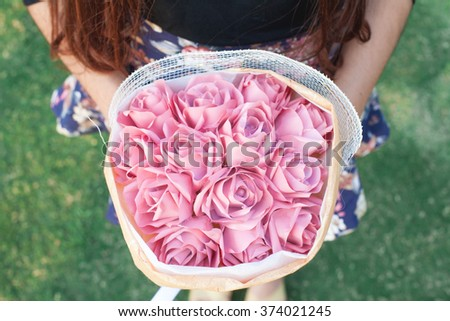 A bouquet of pink roses in girl Hand - stock photo